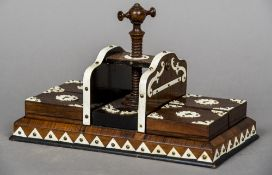 A Victorian ivory mounted rosewood press With central turning screw flanked by four boxes,