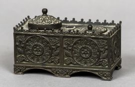 A 19th century Continental Empire inkwell Of florally cast rectangular form inset with a lidded