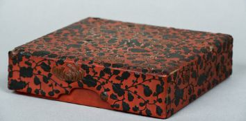 A 19th century Chinese cinnabar lacquer box The removable lid decorated with scrolling