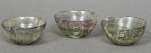 Three small rock crystal bowls Each of simple footed form with a green hue. Each 5 cm diameter.