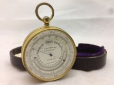 A 19th century gilt metal cased pocket barometer and thermometer by T W Watson, Pall Mall,