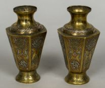 A pair of Eastern white and yellow metal inlaid brass vases Of hexagonal section,
