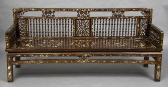 A 19th century Chinese mother-of-pearl inlaid hardwood bench The pierced and turned back and arms