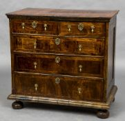 An 18th century walnut chest of drawers The crossbanded moulded rectangular top above an
