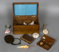 A collection of various shells and fossils and related items Housed in a 19th century walnut box,