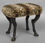 An 18th/19th century carved oak foot stool The leopard fur upholstered top above the carved legs