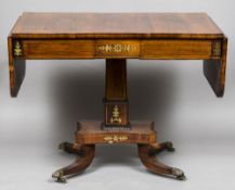 A Regency brass inlaid rosewood sofa table The boxwood line inlaid twin flap rounded rectangular