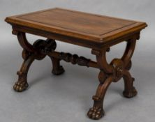 A 19th century mahogany X-framed stool The panelled rectangular top above the scrolling X-frame