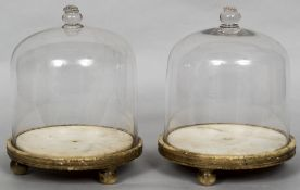 A pair of early 19th century glass domes Each with a knop finial,