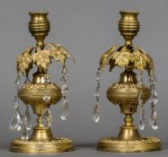 A pair of 19th century ormolu lustre candlesticks 20.5 cm high.