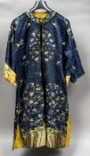 A 19th century or earlier Chinese embroidered silk jacket Worked with floral sprays,