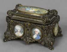 A 19th century painted miniature inset bronze casket The hinged lid inset with a floral miniature,
