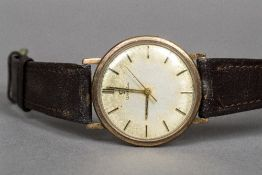 A 9 ct gold gentleman's Omega wristwatch The circular dial with batons. 3.5 cm wide.