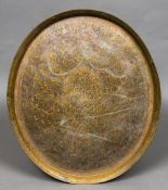 A large Eastern, probably Indian, brass tray Of flared lipped oval form,
