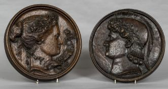 Two late 19th century carved oak roundels One depicting the bust in profile of a classical young