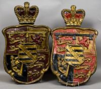 A pair of 19th century papier mache heraldic crests Each surmounted with a crown. Each 99 cm high.