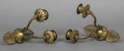 A pair of French Empire gilt bronze wall sconces Each pierced back issuing twin branches.
