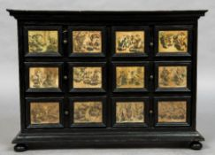 A 18th/19th century Continental ebonised table cabinet The moulded cornice above an arrangement of