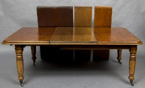 A Victorian mahogany pull-out extending dining table The moulded rectangular top incorporating four