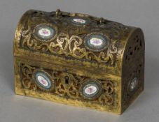 A 19th century French gilt bronze casket Of pierced scrolling hinged domed form set with Sevres