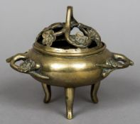 A 19th century Chinese bronze censor With removable pierced florally decorated lid above the main