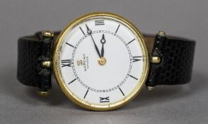 A Sarcar 18 ct gold wristwatch The white circular dial with Roman numerals and batons. 3 cm wide.