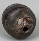 A 19th century carved coconut bugbear Of typical form,