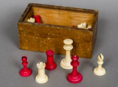An early 20th century ivory and stained ivory Staunton pattern chess set The Kings approximately 6.