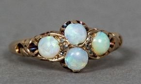 A Victorian unmarked gold opal set ring Of quatrefoil form.