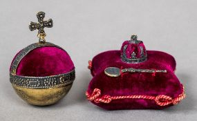 Two late 19th/early 20th century pin cushions One formed as an orb,