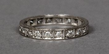 An 18 ct white gold eternity ring Of typical form.
