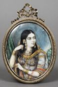 INDIAN SCHOOL (19th/20th century) Portrait of a Maharani Watercolours probably on ivory,