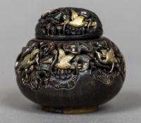 A small Chinese carved pierced horn box and cover Decorated with gilt birds. 6.5 cm high.