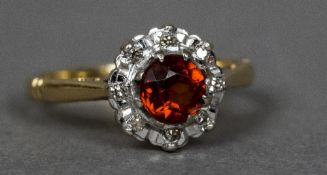 An 18 ct gold diamond and citrine cluster ring CONDITION REPORTS: Generally in good