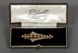 A French 18 ct gold diamond and seed pearl set brooch Of pierced slender fan form. 5 cm long.