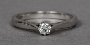 A platinum diamond solitaire ring The single claw set stone above pierced shoulders.