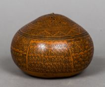 A carved gourd, probably South American Decorated in the round with figural processions and animals.