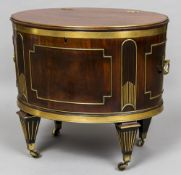 An early 19th century brass bound and inlaid mahogany cellaret Of oval form,