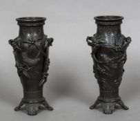 A pair of 19th century Japanese bronze vases Each worked with birds amongst fruiting boughs,