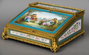 A 19th century ormolu mounted porcelain inset writing slope Inset with Sevres type painted