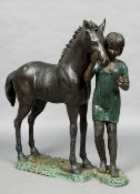 A large patinated bronze model of a girl with a pony The base with a plaque inscribed Bronze Elite