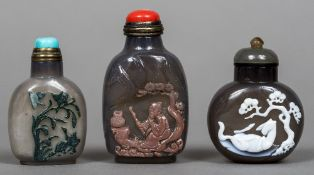 Three Chinese cameo carved glass snuff bottles and stoppers One worked with a sage,