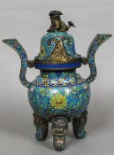 A 19th century Chinese cloisonne twin handled tripod censor and cover The pierced cover with temple