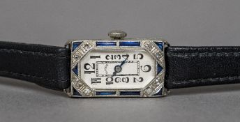 An Art Deco 18 ct white gold diamond and sapphire set lady's cocktail watch The inside of the case
