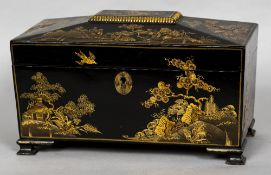 A 19th century chinoiserie lacquered tea caddy The hinged cover enclosing three lidded compartments,