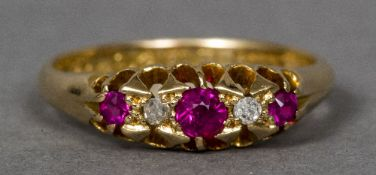A Victorian 18 ct gold diamond and ruby ring Of pierced navette form.