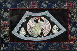 A Chinese needlework panel Worked with a stylised crane, framed and glazed. 26 x 39 cm.