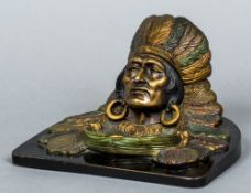 A Continental cold painted bronze inkwell Worked as a Native American wearing traditional headdress,
