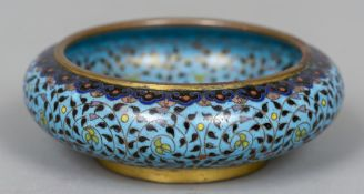 A Chinese cloisonne bowl Decorated overall with lotus strapwork. 11.5 cm diameter.