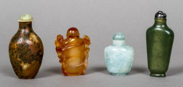A Chinese carved jade snuff bottle Decorated in the round with floral sprays and with twin
